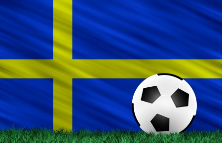 Soccer ball on grass field and  Sweden flag photo