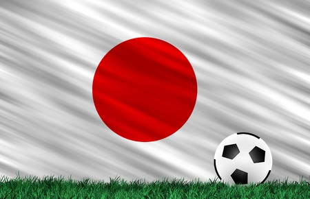 Soccer ball on grass field and  Japan flag Stock Photo - 13826732