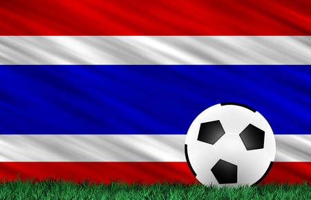 Soccer ball on grass field and  Thailand flag photo