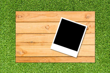 photoframe on wood and grass background photo