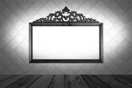 photoframe on wood and leather background, black & white