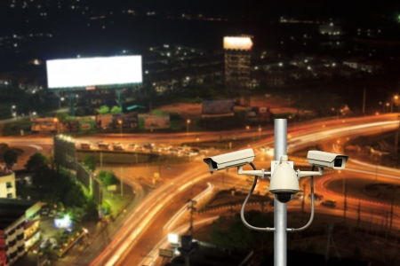 security technology: traffic cameras with top view road at night background