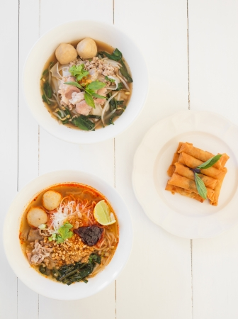 mix asian noodle soup and spring roll