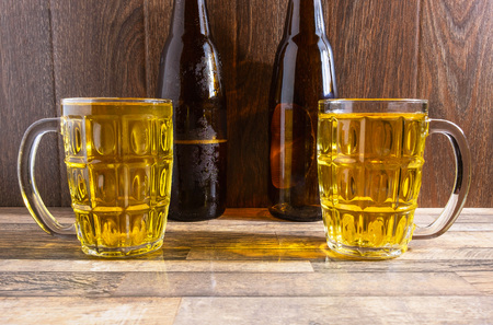 Beer Glass and Beer Bottles on the Table Stockfoto