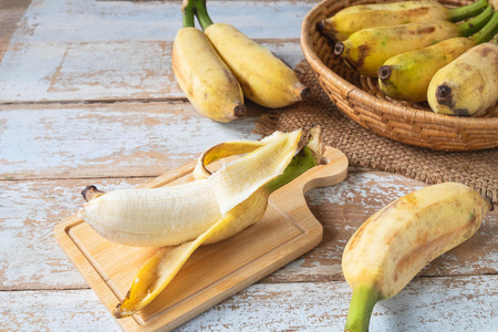 Fresh Bananas on a Wood Background