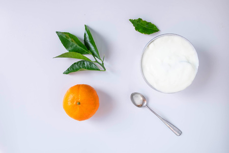 Natural yogurt and citrus fruit On a white background