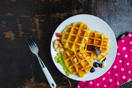 Delicious waffles in a plate on the table Фото со стока
