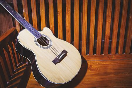 Classical guitar on old wooden background