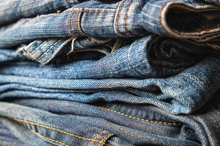 Stack of blue jeans Beauty and fashion clothing