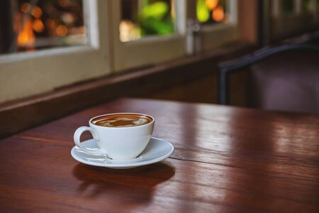 Coffee cups on a wooden table in a coffee shop