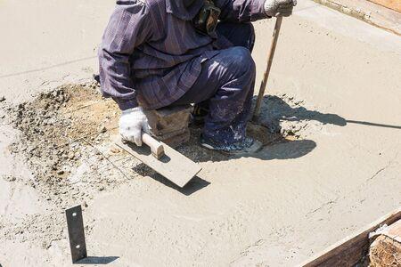 Construction workers plastering cement Standard-Bild