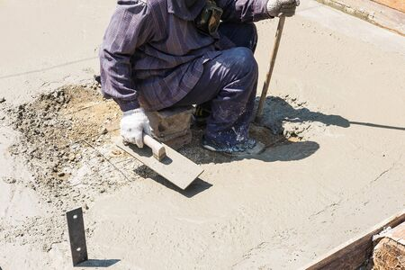 Construction workers plastering cement Banco de Imagens