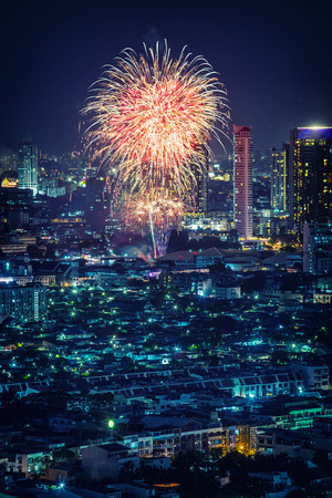 Bangkok cityscape and village view with fireworks night scene photo