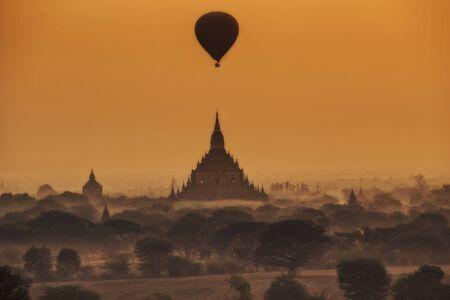balloon over pagoda fields, Scenic sunrise at bagan myanmar photo