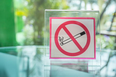 interdiction: No smoking sign on green background Stock Photo