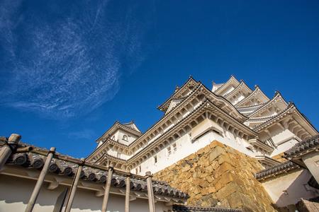 ninja ancient: Ancient Samurai Castle of Himeji with Blue Cloudy Sky. Japan. Stock Photo