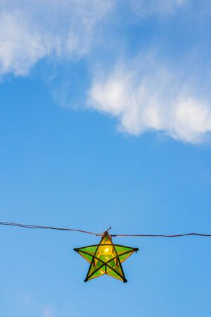 sky lantern: green lantern star on blue sky background