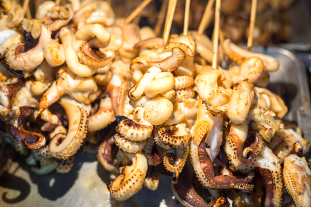 broiling: BBQ Squid on a Stick. grilled buttered fresh squid ready to eat