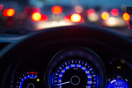 The car console, waiting in a traffic jam at evening