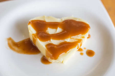 poured: Mashed potato heart-shaped with gravy poured over