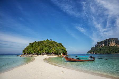 Longtail boat at famous sunny Long Beach, Krabi Thailand, Andaman sea