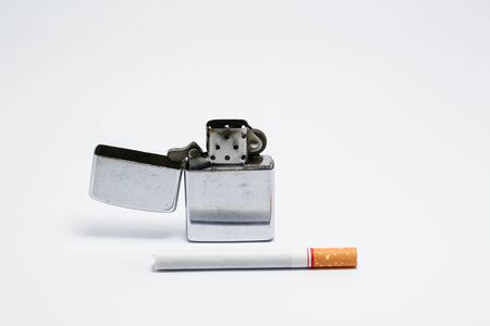 unlit: Cigarette and lighter on white. Isolated photo of an object with white background Stock Photo