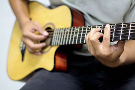 practicing: Practicing in playing guitar. Stock Photo