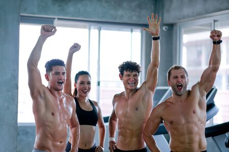 Soft blur of group of sport men and woman show action of happy, encourage or zippy after exercise in gym. Concept of good activities to get better health to prevent disease include occur from virus.