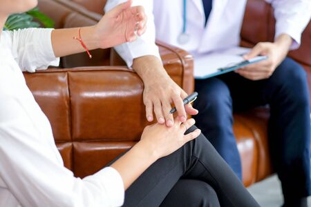 Close up hands of doctor touch to patient hands to encourage patient with mental health problem. Concept of good support in healthcare system for better life of patients. Banque d'images