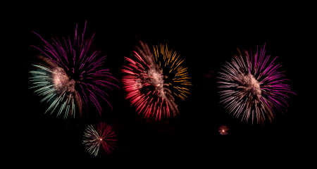 Fireworks with different color and pattern for celebration in various events including new year, party, ceremony, birthday or other show and display on night dark sky background. Stock fotó