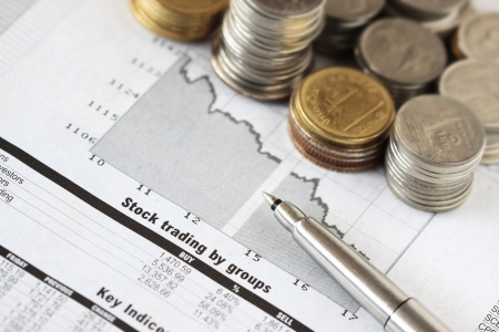 viability: Stock Market Analysis with Pen and Money Stock Photo