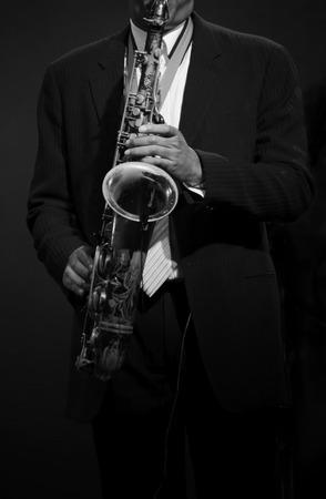 the tenor: Man Playing Tenor Saxophone (Black and White)
