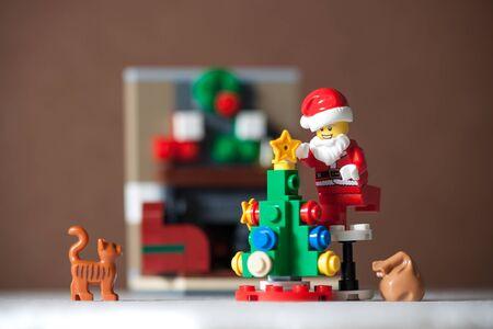 Bangkok, Thailand. December 14,2016 - Santa Claus Lego minifigure preparing christmas tree decorations with cat. Studio shot