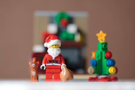 Bangkok,Thailand. December 14,2016 - Santa Claus Lego minifigure holding bag with cat and christmas tree. Studio Shot Editoriali