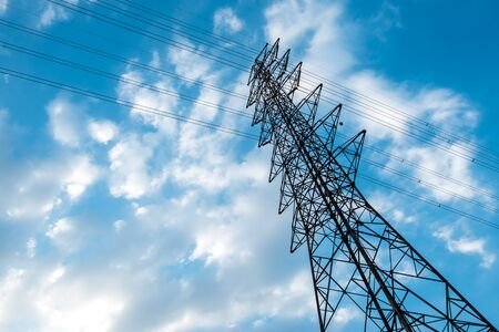 high voltage electric transmission tower with blue sky