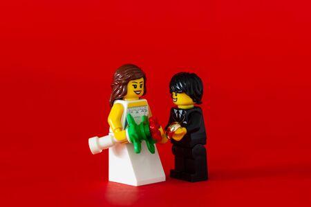 Bangkok,Thailand. January 19,2020 - Wedding Couple of lego minifigure. bride and groom on red background. Studio Shot