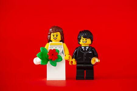 Bangkok,Thailand. January 19, 2020 - Wedding Couple of lego minifigure. bride and groom on red background. Studio Shot