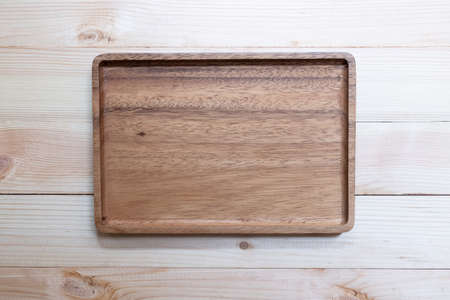 Empty wooden tray, cutting board.Table background. Top view.