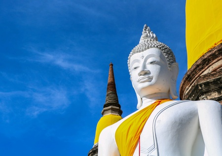 White Buddha statue with blue sky