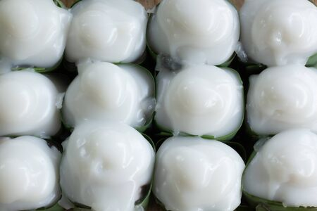 Traditional Thai dessert, white appearance, wrapped with banana leaves