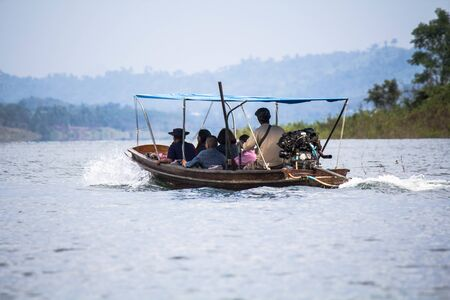 Small boats with tourists were cruising.