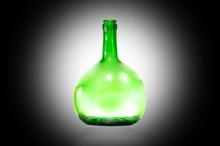 Green bottle, white light on a black background