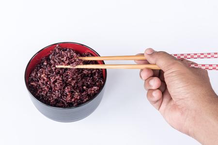 thai brown rice on the black bowl Foto de archivo