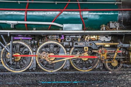 Wheels and connecting rod of old steam locomotive on railway Stock Photo