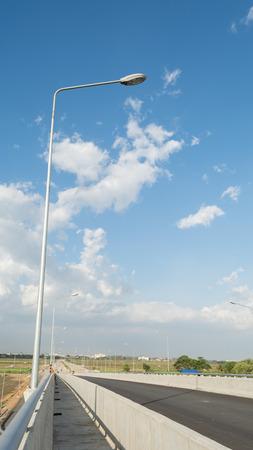 Streetlight isolated on blue sky photo