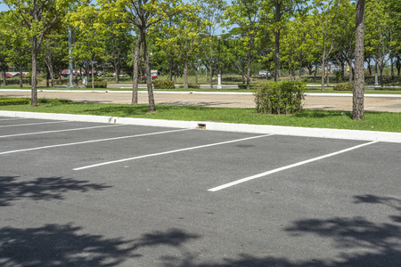 Empty parking lot with trees