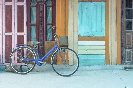 retro: Bicycle on vintage wooden house wall