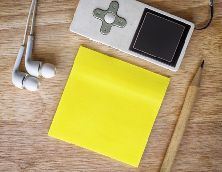 yellow paper: Note paper on a wooden desk. Vintage tone Stock Photo