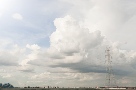 cloud drift: Cloud with High Voltage Electric Transmission Tower Energy Pylon against
