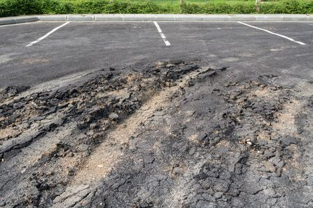 uneven: Asphalt surface on the street was demolished due to poor construction.
